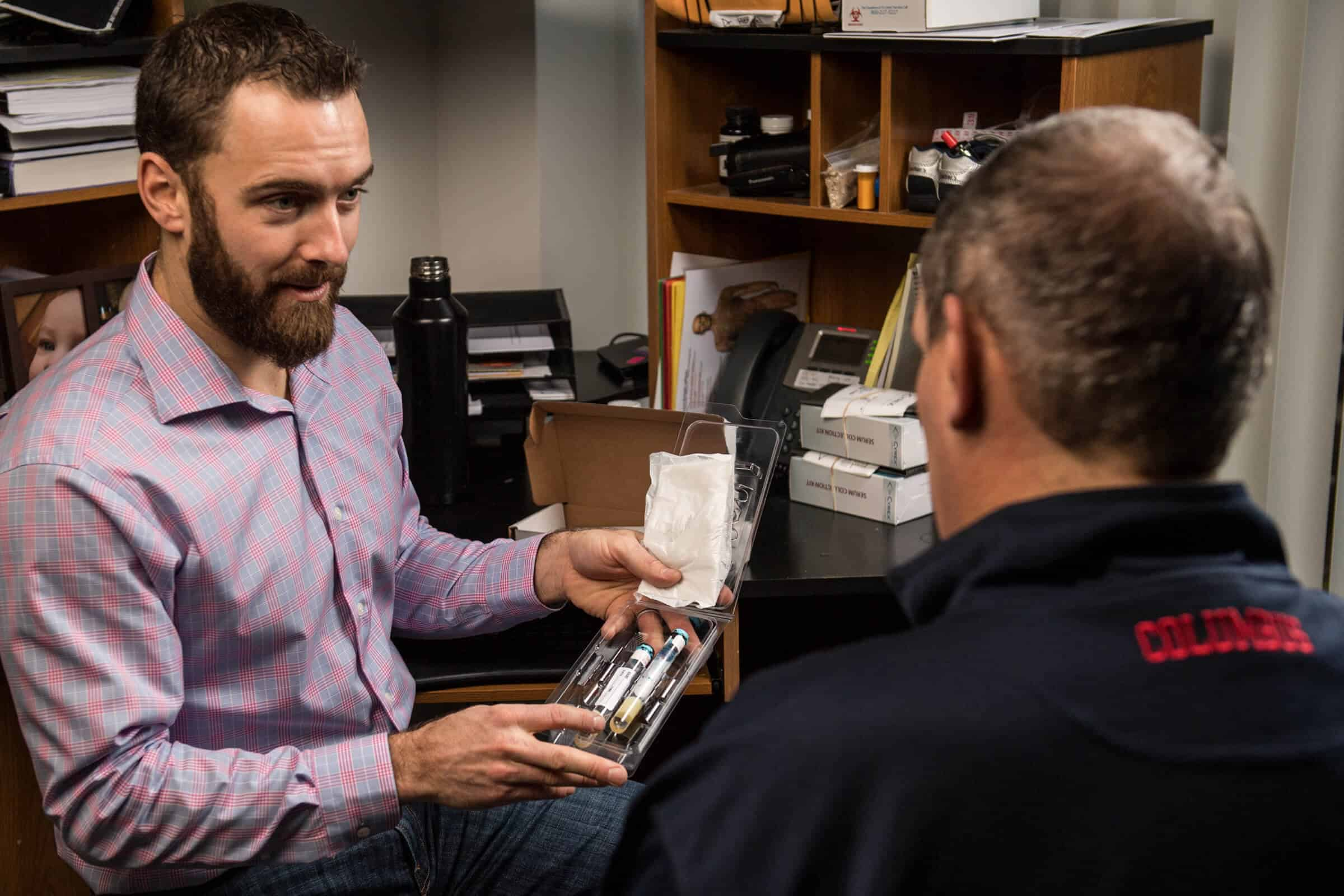 Erik Hensel reviewing medication with patient