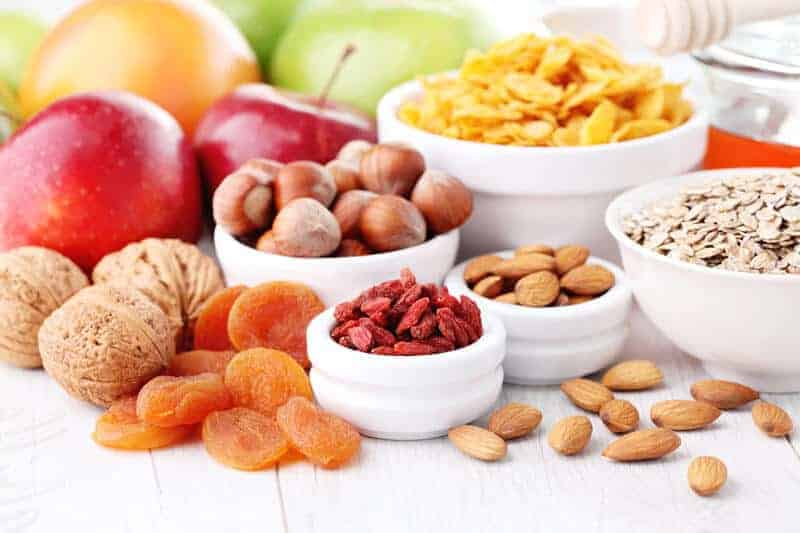 healthy nuts and fruit in bowls