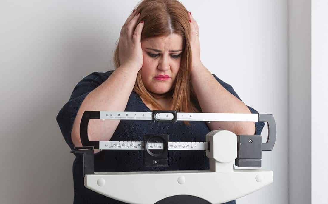 woman stressed out due to weight loss resistance