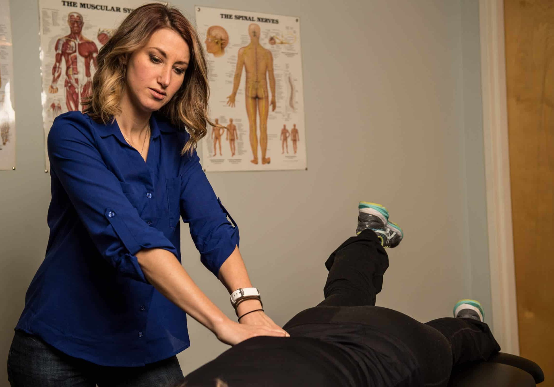 Dr. Craner putting pressure on a patients back to relieve pain