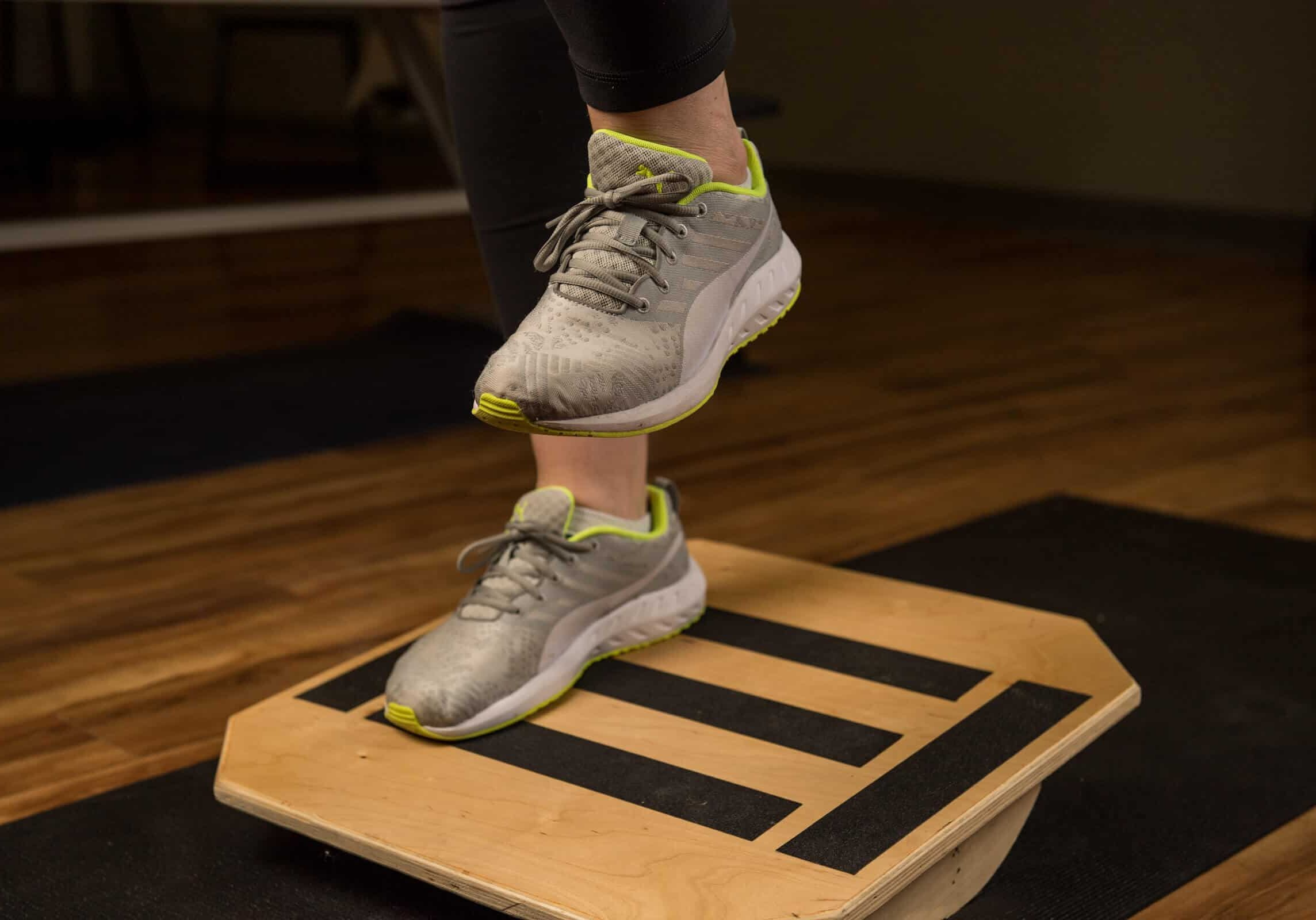 balancing training on one foot while standing on a platform