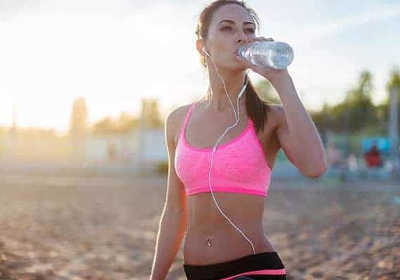 fit woman sports nutrition and water hydration