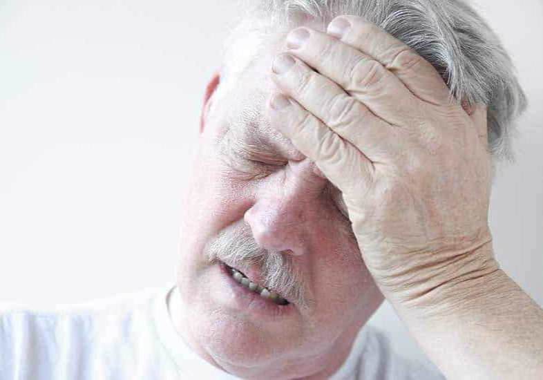 man feeling dizzy and confused