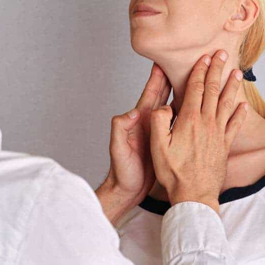 patients neck being examined by doctor