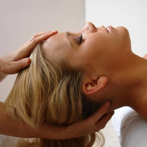 woman getting a neck massage and adjustment